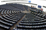 An almost empty European Parliament listens to Belgium's Louis Michel, the European Commissioner for Development and Humanitarian Aid, Tuesday April 22, 2008 in Strasbourg, eastern France. The debate focused on unrest caused by rising food prices. (AP Photo/Cedric Joubert)